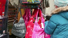 Woman chooses bag in shop souvenirs in Vienna, Austria Stock Footage