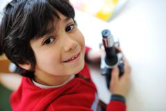 cute little kid holding microscope - stock photo