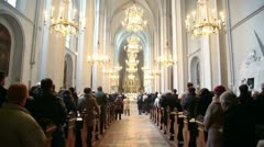 People in Sacred Augustines church stand during worship service Stock Footage