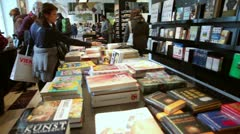 People choose books on shelves in bookstore in museum Albertina Stock Footage