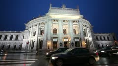 Look in the evening on Burgtheater Vienna and passing by car Stock Footage
