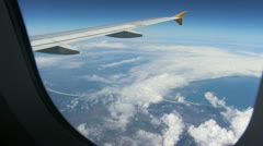 Plane wing in air with window in shot Stock Footage