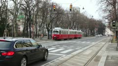 Tram and cars begin movement on traffic light on city streets Stock Footage
