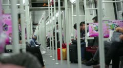 People within quickly riding subway train with rack handrails Stock Footage