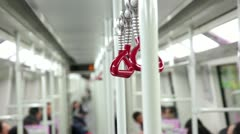 Handgrip and metal handrail in Chinese subway train Stock Footage