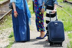 three women traveling - stock photo