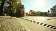 Stock Video Footage of low angle shooting of the tram crossing the sun in Vienna