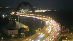 Zoom on night traffic on Zhivopisny bridge over river Stock Footage