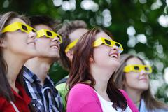 Group of friends in the park wearing 3d glasses Stock Photos