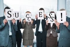 successful business team holding white papers success - stock photo