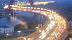 Evening city: bridge car traffic over river unfocused. Timelapse Stock Footage