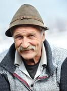 closeup artistic photo of aged man with  grey mustache - stock photo