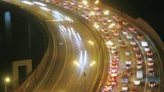 Night city: illuminated bridge with traffic. Timelapse Stock Footage