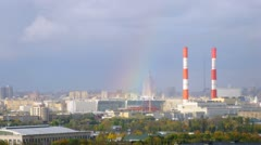 Urban scene: city panorama with rainbow. Timelapse Stock Footage
