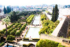 gardens at the alcazar de los reyes cristianos in cordoba, spain - stock photo