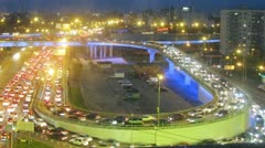 Illuminated bridge with car traffic and parking lot. Timelapse Stock Footage