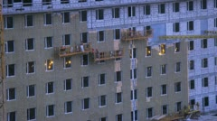 Workers making insulation high-rise building. Timelapse Stock Footage