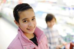 beautiful girl in shopping mall with her brother - stock photo