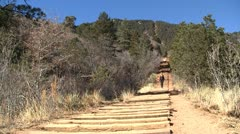 Woman walking down the manitou incline from right Stock Footage