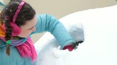 Making hole in snowy car rear window - stock footage