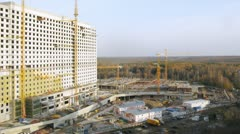 Parking and building in construction. Timelapse Stock Footage