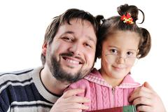 closeup image of father and daughter - stock photo