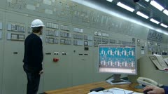 Industrial workers in control room Stock Footage