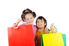 Little kids with shopping bags Stock Photos