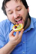 adult man eating delicious cake - stock photo