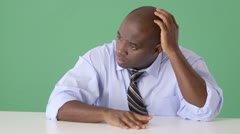 African American businessman thinking at desk Stock Footage