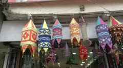 Colorful cloth lamps in Delhi  market, India Stock Footage