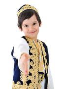 Cute middle-eastern child extending hand to shake Stock Photos