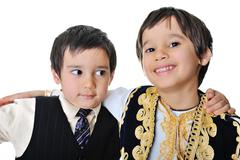 Close up portrait of brothers over white background Stock Photos