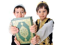 two beautiful kids holding holy quran - stock photo