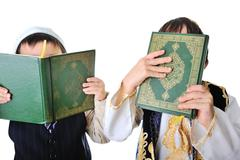 two boys with holy quran - stock photo
