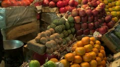 Fruits in night asia market and incence smoke Stock Footage