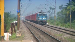 Freight Goods train passes through station in India - stock footage