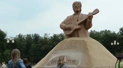 John lennon beatles sculpture people vilnius lukiskiu square Stock Footage