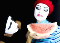 mimes and a water-melon - stock photo