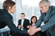 Stock Photo of young business woman passed on a job interview shaking hands with boss