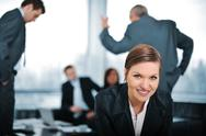 Young businesswoman with colleagues in background Stock Photos