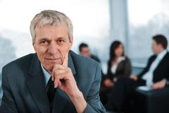 business team with manager sitting in front - stock photo