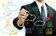Stock Illustration of businessman with cloud computing themed pictures