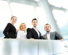 successful business people on railing - stock photo