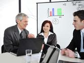 Business meeting - group of people in office at presentation Stock Photos