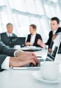 business ambience, working on laptop during the meeting - stock photo