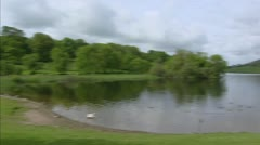 Lakeside with trees - pan right -  Lough Gur, Stock Footage