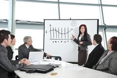 Businesswoman drawing a diagram during the presentation at office Stock Photos