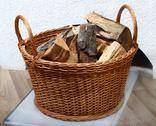 Basket of firewood Stock Photos