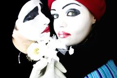 Mimes with a flower Stock Photos